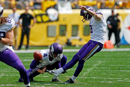 Minnesota Vikings kicker Kai Forbath (2) kicks a field goal out of the hold by Ryan Quigley (4) during the first half of an NFL football game against the Pittsburgh Steelers in Pittsburgh