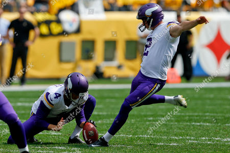 Minnesota Vikings kicker Kai Forbath (2) kicks a field goal from the hold of Ryan Quigley during the first half of an NFL football game in Pittsburgh against the Pittsburgh Steelers