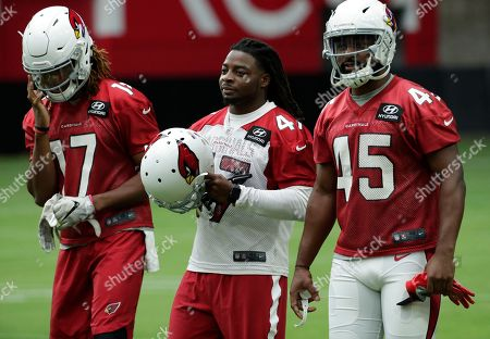 Stock Photo of Arizona Cardinals wide receiver Larry Clark (17), defensive back Ironhead Gallon (47) and James Summers (45) arrive during the Cardinals' first day of NFL football training camp, in Glendale, Ariz
