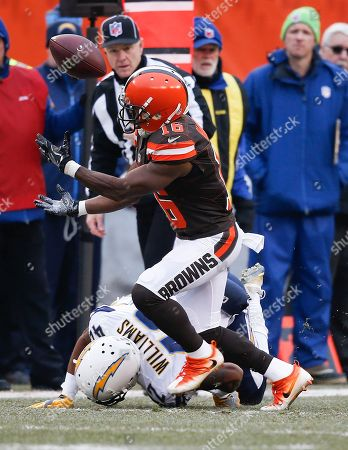 Cleveland Browns wide receiver Andrew Hawkins (16) catches a pass against San Diego Chargers cornerback Trevor Williams (42) in the first half of an NFL football game, in Cleveland