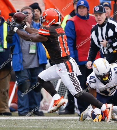 Andrew Hawkins, Trevor Williams. Cleveland Browns wide receiver Andrew Hawkins (16) catches a pass against San Diego Chargers cornerback Trevor Williams (42) in the first half of an NFL football game, in Cleveland