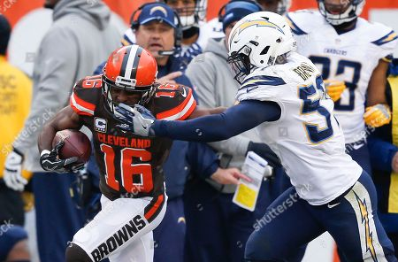 Cleveland Browns wide receiver Andrew Hawkins (16) is tackled by San Diego Chargers inside linebacker Jatavis Brown (57) in the first half of an NFL football game, in Cleveland