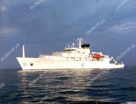 In this undated photo released by the U.S. Navy Visual News Service, the USNS Bowditch, a T-AGS 60 Class Oceanographic Survey Ship, sails in open water. The USNS Bowditch, a civilian U.S. Navy oceanographic survey ship, was recovering two drones on Thursday when a Chinese navy ship approached and sent out a small boat that took one of the drones, said Navy Capt. Jeff Davis, a Pentagon spokesman. He said the Chinese navy ship acknowledged radio messages from the Bowditch, but did not respond to demands the craft be returned