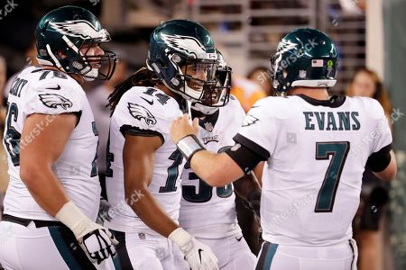 Philadelphia Eagles quarterback Dane Evans (7) and wide receiver Marcus Johnson (14) celebrate after connecting for a touchdown pass against the New York Jets during the second half of an NFL football game, in East Rutherford, N.J