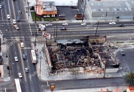 Stock Picture of This 1992 crime scene photo provided by the Los Angeles Police Department shows a burned-out Pep Boys store, destroyed during the 1992 Rodney King riots in Los Angeles. A body was found in the ruins. After a quarter of a century, a victim of the Los Angeles riots has a name. Police said that John Doe No. 80 is Miguel Armando Quiroz Ortiz. His body was found in May, 1992 in the Pep Boys store that was among the many burned down during the riots in South Los Angeles. He was 18 at the time and had come to the U.S. from Mexico