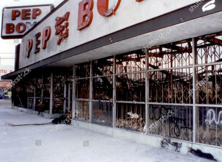 This 1992 crime scene photo provided by the Los Angeles Police Department shows a burned-out Pep Boys store, destroyed during the 1992 Rodney King riots in Los Angeles. A body was found in the ruins. After a quarter of a century, a victim of the Los Angeles riots has a name. Police said that John Doe No. 80 is Miguel Armando Quiroz Ortiz. His body was found in May, 1992 in the Pep Boys store that was among the many burned down during the riots in South Los Angeles. He was 18 at the time and had come to the U.S. from Mexico