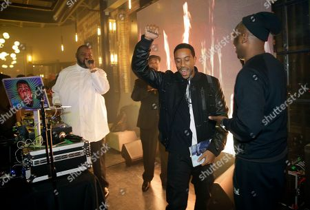 "Christopher ""Ludacris"" Bridges stands onstage with Biz Markie, left, at the NFL Media Super Bowl party at Chapman & Kirby"