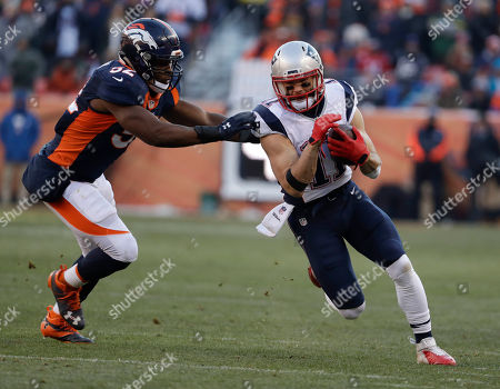New England Patriots wide receiver Julian Edelman, right, is pushed out by Denver Broncos inside linebacker Corey Nelson during the first half of an NFL football game, in Denver