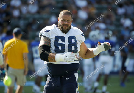 Los Angeles Chargers' Matt Slauson warms up during an NFL football training camp at StubHub Center, in Carson, Calif
