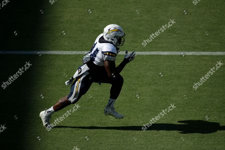 Los Angeles Chargers' Andre Williams carries the ball during an NFL football training camp at StubHub Center, in Carson, Calif