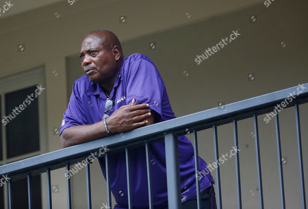 Baltimore Ravens general manager and executive vice president Ozzie Newsome looks out over practice fields following an NFL football training camp practice in Owings Mills, Md