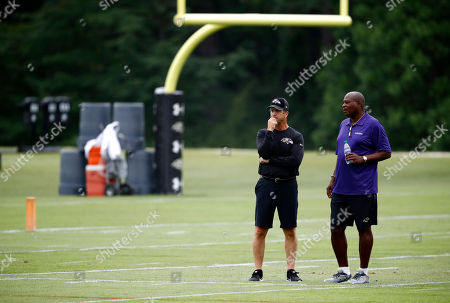 John Harbaugh, Ozzie Newsome. Baltimore Ravens head coach John Harbaugh, left, and general manager and executive vice president Ozzie Newsome watch an NFL football training camp practice in Owings Mills, Md