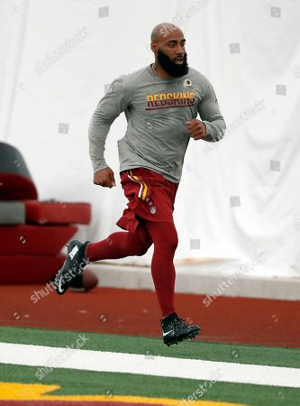 Washington Redskins safety DeAngelo Hall (23) runs during practice at the team's NFL football training facility at Redskins Park, in Ashburn, Va