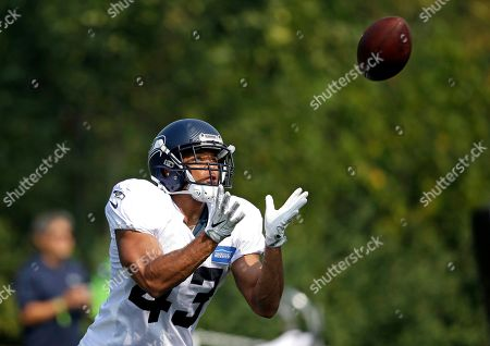 Seattle Seahawks' Marcus Cromartie reaches for the ball during an NFL football training camp, in Renton, Wash