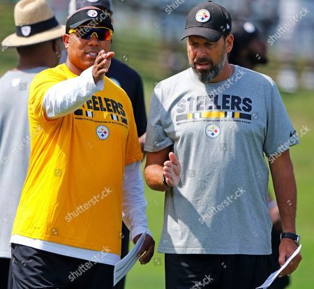 Pittsburgh Steelers receivers coach Hines Ward, left, talks with offensive coordinator Todd Haley during a practice at the NFL football team's training camp in Latrobe, Pa., on
