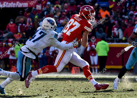 Kansas City Chiefs tight end Travis Kelce (87) is tackled by Tennessee Titans defensive back Valentino Blake (47) after making a catch during their NFL football game in Kansas City, Mo