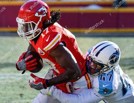 Kansas City Chiefs wide receiver Chris Conley (17) is tackled by Tennessee Titans defensive back Valentino Blake (47) during their NFL football game in Kansas City, Mo