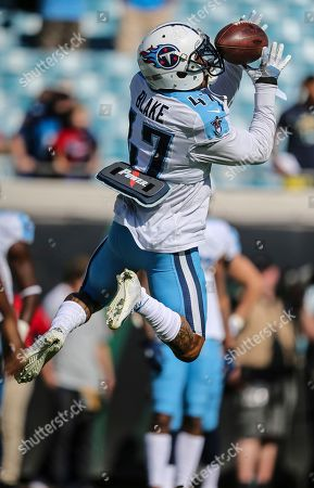 Tennessee Titans defensive back Valentino Blake warms up before an NFL football game against the Jacksonville Jaguars, in Jacksonville, Fla