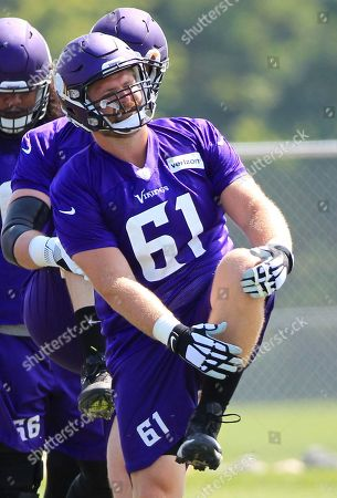 Minnesota Vikings center Joe Berger (61) stretches during NFL football training camp, in Mankato, Minn