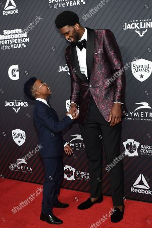 """S.I. Kids SportsKid of the Year honoree Maxwell """"Bunchie"""" Young, left, meets rising star award recipient Joel Embiid"""