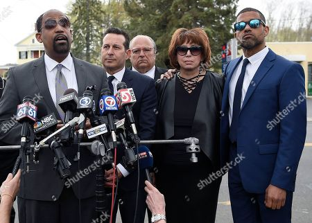 Aaron Hernandez's defense attorneys, from left, Ronald Sullivan, Jose Baez, George Leontire, Linda Kenney Baden and Robert Proctor speak after a private service for Hernandez at O'Brien Funeral Home, in Bristol, Conn. The former New England Patriots tight end was found hanged in his cell in a maximum-security prison on Wednesday