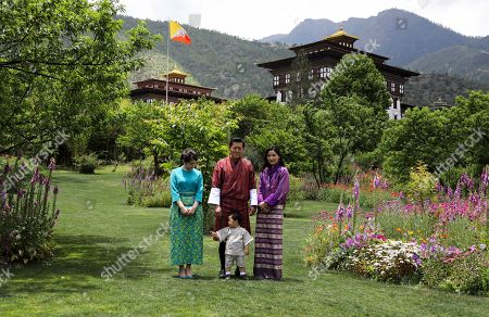 In this handout photograph released by Royal Office for Media Bhutan, Japan's Princess Mako, left, the granddaughter of Emperor Akihito, watches Jigme Namgyel Wangchuck son of Bhutan's King Jigme Khesar Namgyal Wangchuck, center, and Queen Jetsun Pema, right, as they pose for a photograph in Thimphu, Bhutan on