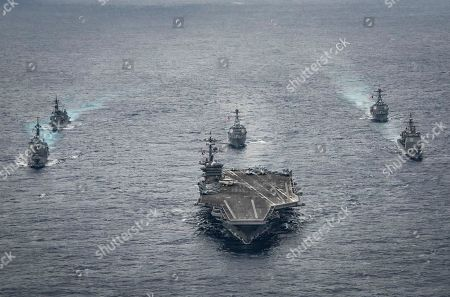 Released by the U.S. Navy, the aircraft carrier USS Carl Vinson leads the Japan Maritime Self-Defense Force destroyers JS Ashigara (DDG 178), left front, and JS Samidare (DD 106), left rear, the Arleigh Burke-class guided-missile destroyers USS Michael Murphy (DDG 112), center rear, and USS Wayne E. Meyer (DDG 108), right rear, and the Ticonderoga-class guided-missile cruiser USS Lake Champlain (CG 57), right front, during a transit the Philippine Sea. The aircraft carrier is taking part in the ongoing joint exercises