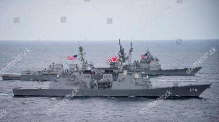 Released by the U.S. Navy, the Japan Maritime Self-Defense Force destroyer JS Ashigara (DDG 178), foreground, the Arleigh Burke-class guided-missile destroyer USS Wayne E. Meyer (DDG 108), center, and the Ticonderoga-class guided-missile cruiser USS Lake Champlain (CG 57) transit the Philippine Sea as they accompany the Nimitz-class aircraft carrier USS Carl Vinson (CVN 70) for the ongoing joint exercises