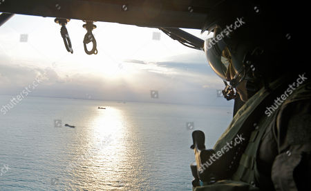 Provided by the Ministry of Defence Singapore, the Republic of Singapore Air Force personnel conduct a search and rescue operation for missing U.S. sailors over waters east of Singapore. The collision between the USS John S. McCain and an oil tanker has exposed a long-simmering dispute between Singapore and Malaysia over which country should control a 60-meter wide guano-encrusted outcropping at the edge of the South China Sea. Malaysia and Singapore both say the accident happened in their territorial waters because of the competing claims to Pedra Branca
