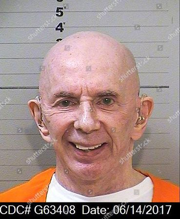 Stock Photo of This mugshot provided by the California Department of Corrections and Rehabilitation shows rock 'n' roll music producer Phil Spector, completely free of the huge hair that was so striking during his murder trial. The 76-year-old music producer is smiling broadly and wearing hearing aids on both ears. He was convicted in 2009 of killing actress Lana Clarkson, and is serving a sentence of 19 years to life