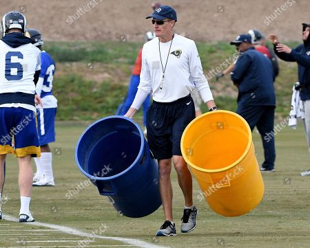 Los Angeles Rams interim head coach John Fassel leads practice at the team's training facility at California Lutheran University in Thousand Oaks, Calif., . Fassel, the team's special teams coach, will replace Jeff Fisher on an interim basis for the final three games of this season. The team's coach since 2012, Fisher compiled a 31-45-1 record with the Rams and oversaw the move from St. Louis to Los Angeles this past offseason