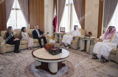 In this April 22, 2017 photo released by the U.S. Defence Department, Secretary of Defense Jim Mattis, centre left, meets with Qatar's Emir Sheikh Tamim bin Hamad Al Thani as Sally Donnelly, Mattis' advisor, 2nd left, and Dana Smith, U.S. ambassador to Qatar, 1st left, and Qatar's Minister of Defence Khalid bin Mohammed al Attiyah are seen at the Sea Palace in Doha, Qatar. A trip by Qatar's ruling emir to a major U.S. military base in his country,, has shown the delicate balancing act the U.S. faces in addressing the diplomatic crisis gripping Doha