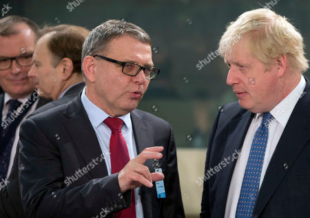 British Foreign Secretary Boris Johnson, right, speaks with Czech Republic's Foreign Minister Lubomir Zaoralek as they attend a meeting of the NATO-Georgia Council at NATO headquarters in Brussels on