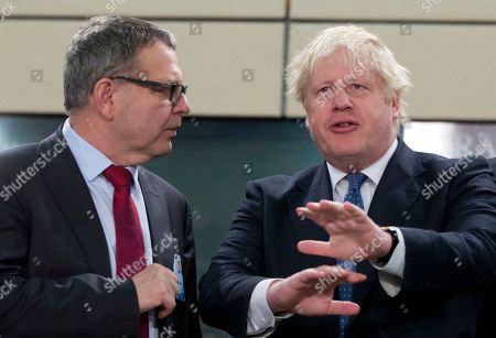 Stock Picture of British Foreign Secretary Boris Johnson, right, speaks with Czech Republic's Foreign Minister Lubomir Zaoralek during a meeting of the NATO-Georgia Council at NATO headquarters in Brussels on