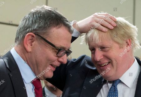 Stock Image of British Foreign Secretary Boris Johnson, right, speaks with Czech Republic's Foreign Minister Lubomir Zaoralek during a meeting of the NATO-Georgia Council at NATO headquarters in Brussels on