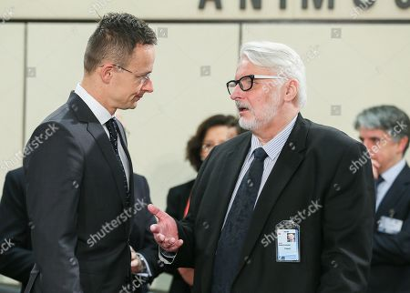 Hungarian Minister of Foreign Affairs and Trade Peter Szijjarto (L) and Polish Minister of Foreign Affairs Witold Waszczykowski attend NATO-Georgia commission foreign ministers at alliance headquarters in Brussels, Belgium, 06 December 2017. NATO Foreign Ministers are meeting on 05 - 06 December 2017 to for two days of talks on NATO's adaptation ahead of the Brussels Summit next July 2018. Ministers will also discuss global security challenges, including North Korea, and NATO's role in projecting stability beyond its borders.
