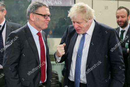 Stock Picture of Czech Foreign Minister Lubomir Zaoralek (L) and British Secretary of State for Foreign and Commonwealth Affairs, Boris Johnson attend NATO-Georgia commission foreign ministers at alliance headquarters in Brussels, Belgium, 06 December 2017. NATO Foreign Ministers are meeting on 05 - 06 December 2017 to for two days of talks on NATO's adaptation ahead of the Brussels Summit next July 2018. Ministers will also discuss global security challenges, including North Korea, and NATO's role in projecting stability beyond its borders.