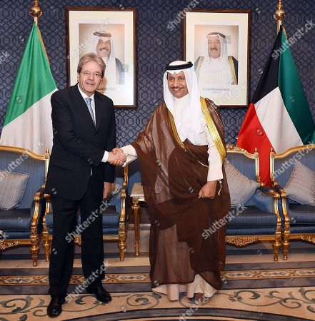 In this handout image provided by the Office of the President of the Kuwaiti Cabinet, Italian Prime Minister Paolo Gentiloni shakes hands with Kuwaiti Prime Minister Sheikh Jaber Al-Mubarak Al-Sabah at the Bayan Palace, Kuwait City