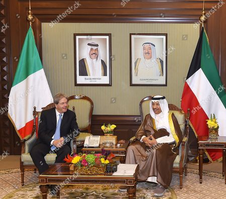In this handout image provided by the Office of the President of the Kuwaiti Cabinet Italian Prime Minister Paolo Gentiloni, left meets with Kuwaiti Prime Minister Sheikh Jaber Al-Mubarak Al-Sabah at the Bayan Palace, Kuwait City