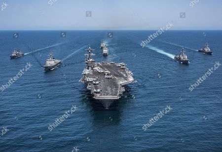 In this image released by the U.S. Navy, the aircraft carrier USS Carl Vinson, flanked by South Korean destroyers, from left, Yang Manchun and Sejong the Great, and the U.S.Navy's Wayne E. Meyer and USS Michael Murphy, transit the western Pacific Ocean . The USS Stethem, rear, and USS Lake Champlain trail behind