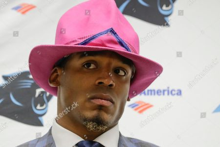 Stock Picture of Carolina Panthers quarterback Cam Newton wears a hat in honor of Craig Sager during the post game press conference after a NFL football game against the Washington Redskins in Landover, Md., . The Panthers defeated the Redskins 26-15