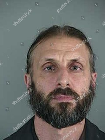 This undated booking photo released by the Lane County Sheriff's Office, shows Daniel James MacKay, a Eugene, Ore., priest, who was arrested Oct. 12, 2016, during a sting operation in which a detective posed as a minor and arranged a meeting with him. Lane County prosecutors have dismissed a felony charge against MacKay, charged with paying for sex with an underage girl. The Register-Guard reports that the move means MacKay will go to trial on nine misdemeanor charges on