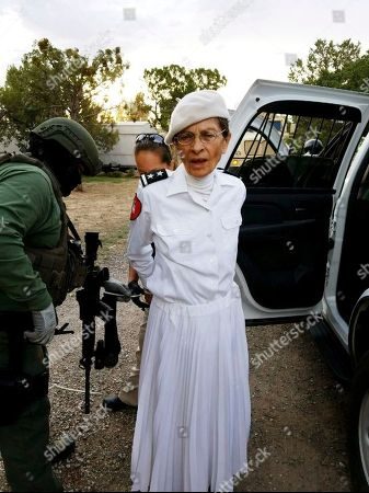 Provided by the Cibola County Sheriff's Office, Deborah Green, leader of the paramilitary Christian sect Aggressive Christianity Missions Training Corps, is arrested outside of the group's secluded Fence Lake, N.M. compound. Deborah Green and Peter Green, the two leaders of a New Mexico paramilitary religious sect, pleaded not guilty, to charges connected to a child abuse investigation