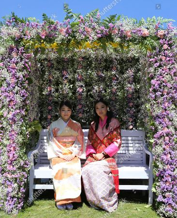 In this handout photograph released by Royal Office for Media Bhutan, Japan's Princess Mako, left, the granddaughter of Emperor Akihito, poses with Bhutan's Queen Jetsun Pema at the Royal Bhutan Flower Exhibition in Paro, Bhutan