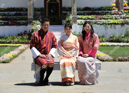 In this handout photograph released by Royal Office for Media Bhutan, Japan's Princess Mako, center, the granddaughter of Emperor Akihito, is flanked by Bhutan's King Jigme Khesar Namgyal Wangchuck, left, and Queen Jetsun Pema, right, as they pose at the Royal Bhutan Flower Exhibition in Paro, Bhutan