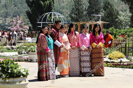 In this handout photograph released by Royal Office for Media Bhutan, Japan's Princess Mako, center, the granddaughter of Emperor Akihito, is flanked by Bhutan's King Jigme Khesar Namgyal Wangchuck, third from left, and Queen Jetsun Pema, third from right, as they pose with unidentified women at the Royal Bhutan Flower Exhibition in Paro, Bhutan