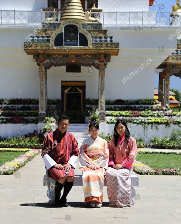Princess Mako, King Jigme Khesar Namgyal Wangchuck, Queen Jetsun Pema. In this handout photograph released by Royal Office for Media Bhutan, Japan's Princess Mako, center, the granddaughter of Emperor Akihito, is flanked by Bhutan's King Jigme Khesar Namgyal Wangchuck, left, and Queen Jetsun Pema, right, as they pose at the Royal Bhutan Flower Exhibition in Paro, Bhutan