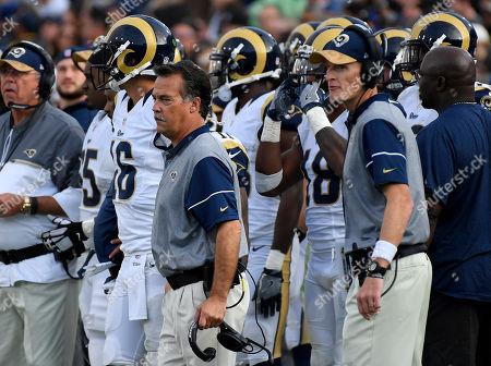 Los Angeles Rams head coach Jeff Fisher, center, stands on the sideline as special teams coordinator John Fassel, right, stands by during the second half of an NFL football game, in Los Angeles. The Rams fired their coach on Monday. Fassel will serve as interim coach