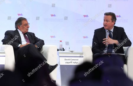 In this photo released by Emirates News Agency, WAM, former CIA director Leon Panetta, left, talks with David Cameron, former Prime Minister of the United Kingdom during the opening day of Arab Strategy Forum in Dubai, United Arab Emirates, . Panetta and Cameron offered simple advice on Wednesday for U.S. President-elect Donald Trump: Have daily intelligence briefings