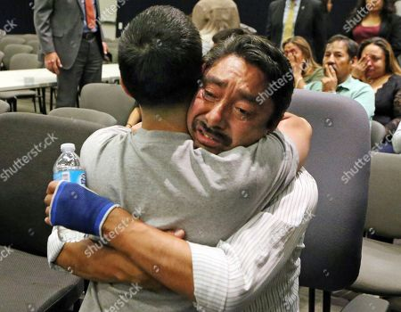Stock Image of Fernando Duran, right, father of murder victim Bree'Anna Guzman, embraces an unidentified man as the Los Angeles Police Department announces the arrest of a suspect in the 2011 kidnapping and murders of two young women, at police headquarters in downtown Los Angeles . Geovanni Borjas, 32, was charged with two counts each of murder and forcible rape, and one count of kidnapping in the deaths of 17-year-old Michelle Lozano and 22-year-old Bree'Anna Guzman, the Los Angeles County district attorney's office said